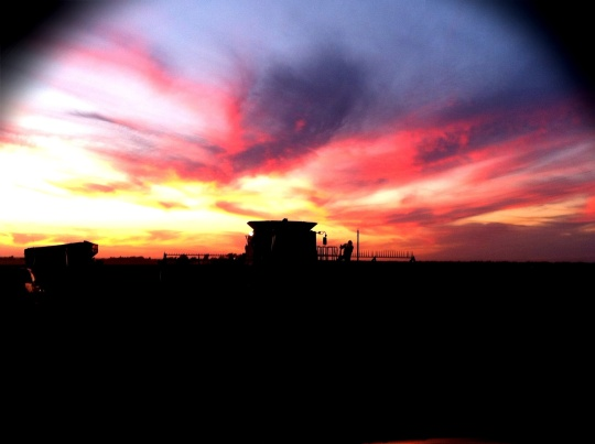 Catching a sunset while delivering a meal to a soybean field.