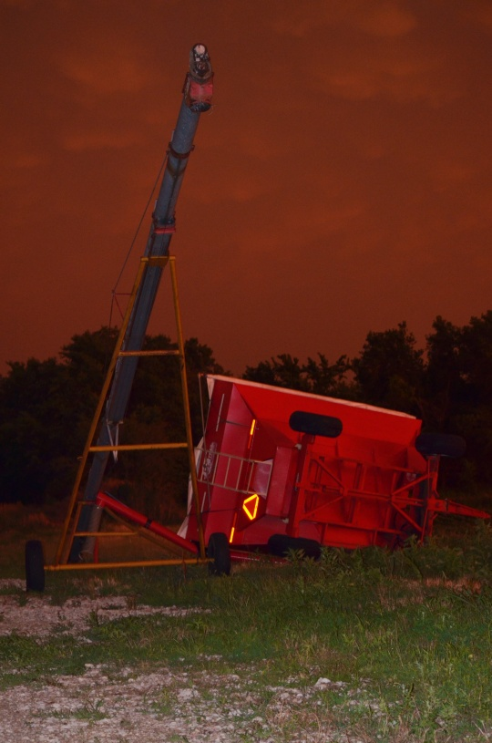 Flipped gravity wagon tangled with one of our augers.